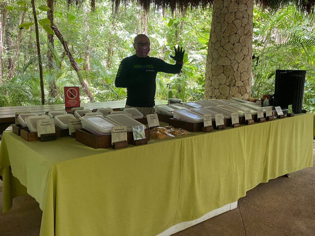 Lunch table platters with guide ready to help serve.  A Guide to Xenotes Water Tours by Xcaret