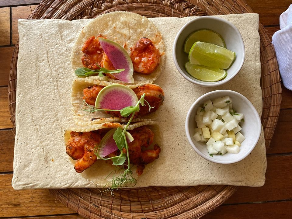 Plate of shrimp tacos on a table.  Guide to Hotel Xcaret in Mexico