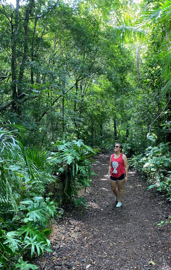 Woman hiking in the mayan jungle.   A Guide to Xenotes Water Tours by Xcaret