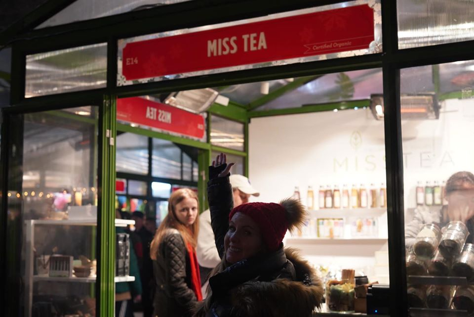 Woman standing in front of Miss Tea store at Bryant Park.   New York City