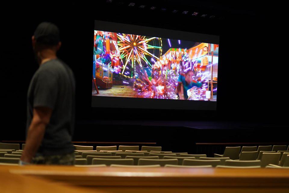 Movie theater with movie playing at the Atlantis resort.   Atlantis, Bahamas