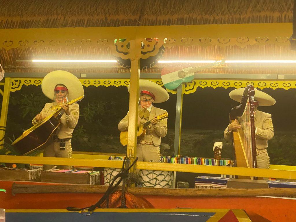 Live musical band playing instruments. | XOXIMILCO Cancun, Mexico