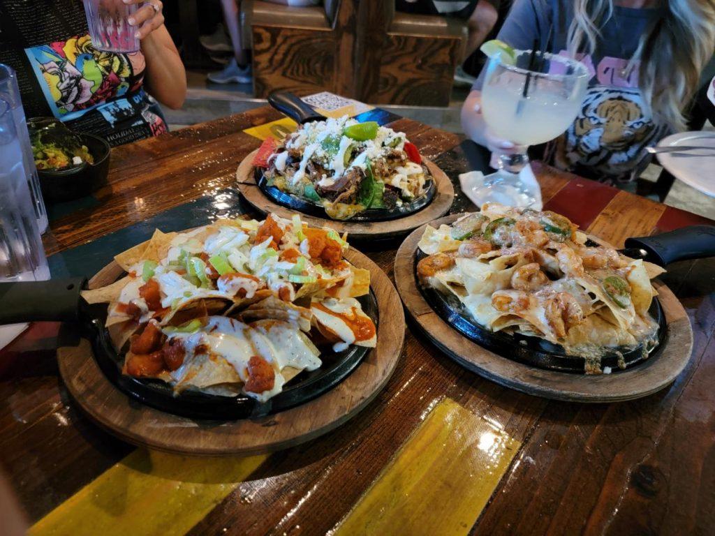 Three plates of nachos on table.   Where to eat in Las Vegas