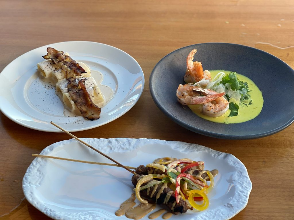 Plates of food at a restaurant. | A Guide to Nobu Hotel Los Cabos - A Relaxing Girls Trip