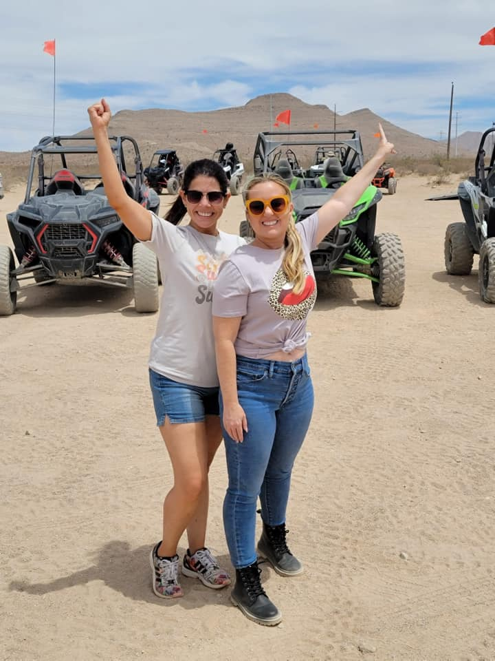 Two women in front of ATVs in desert.   Non-Gamblers Guide to Las Vegas