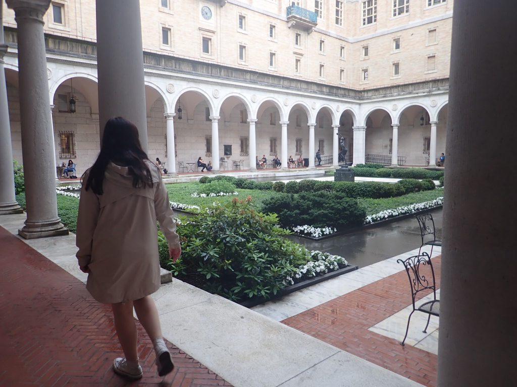 Woman walking outside the Boston Public Library in Boston. | Boston, Massachusetts- Adult Getaway