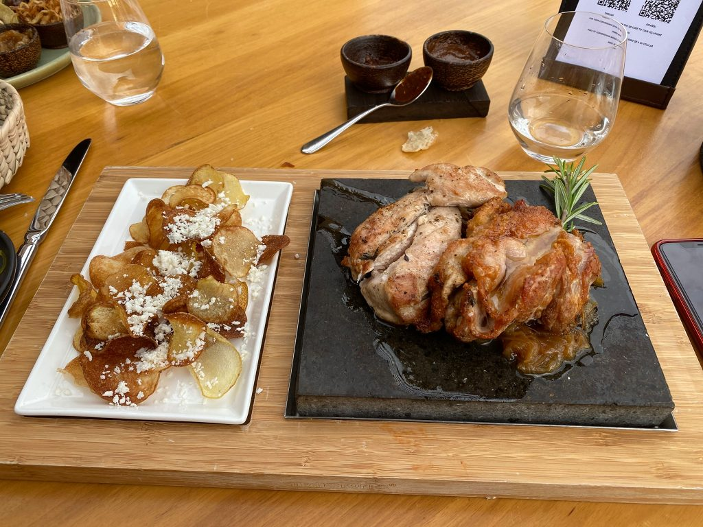 Plates of dinner food including chips and chicken.| A Guide to Nobu Hotel Los Cabos - A Relaxing Girls Trip