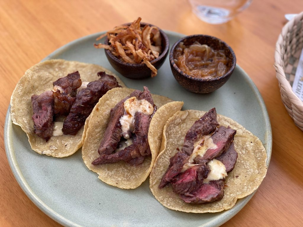 Plate of pacific food tacos with sauces. | A Guide to Nobu Hotel Los Cabos - A Relaxing Girls Trip