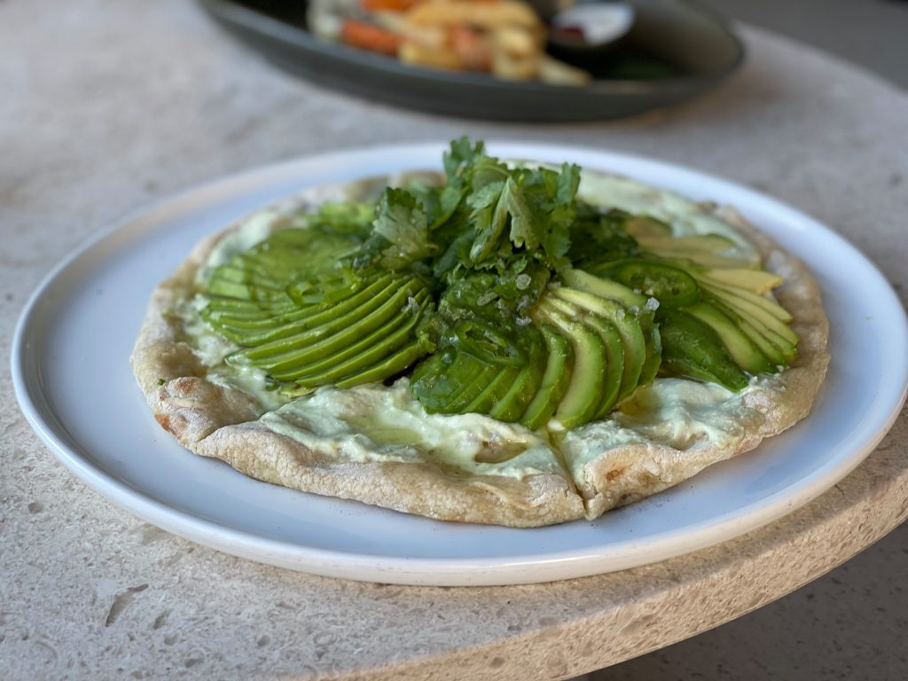Plate of flatbread with avocado.| A Guide to Nobu Hotel Los Cabos - A Relaxing Girls Trip