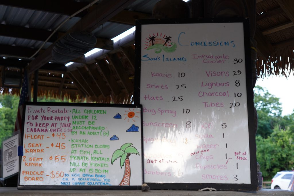 Price board for food and excursions at Son's Island.| Son's Island in Seguin, Texas