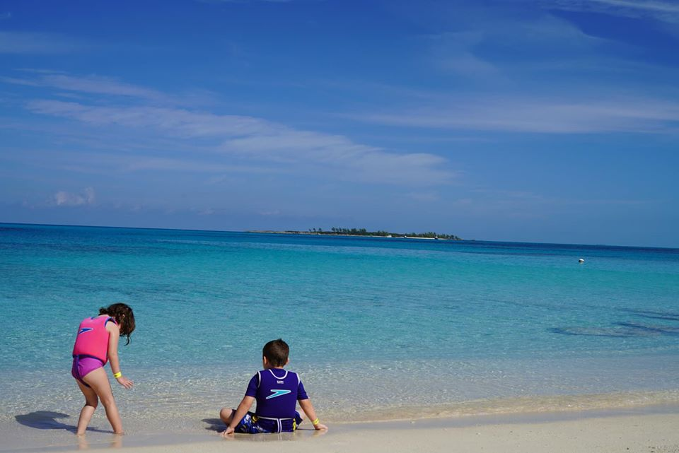 Kids hanging out on a private island on the beach at the Atlantis resort.   Atlantis, Bahamas