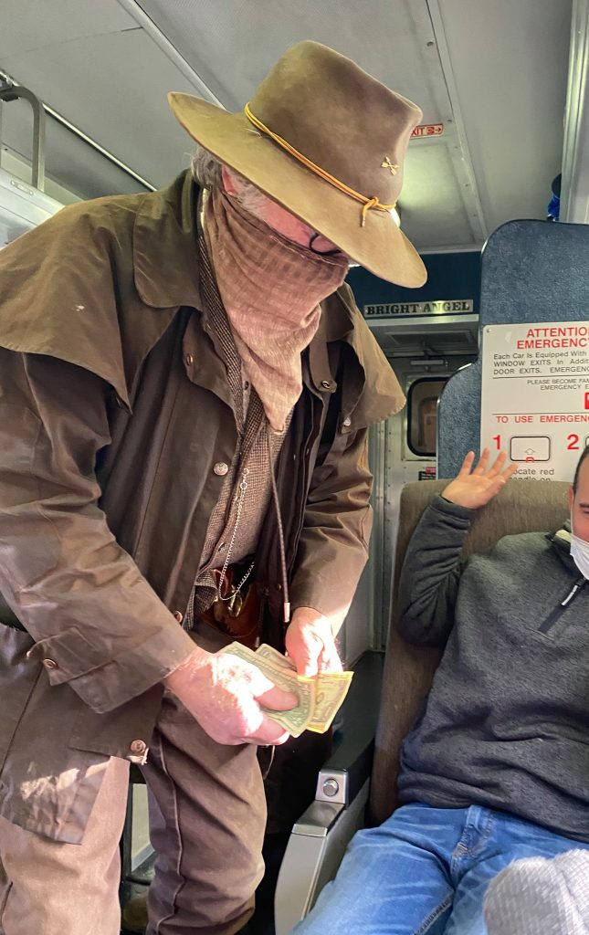 Role play robbery with man robbing a train passenger during the grand canyon railway train ride. | Arizona Itinerary with Kids