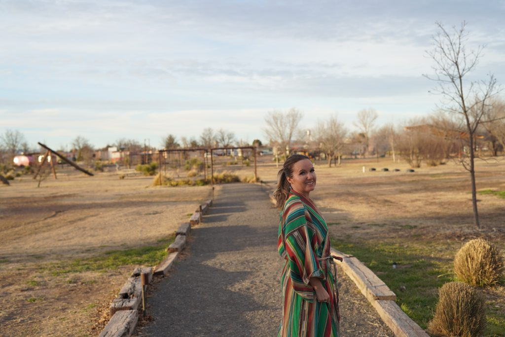 Woman wearing striped robe at El Cosmico in Marfa. | Marfa, Texas- Where to Stay, What to do, & What to Eat