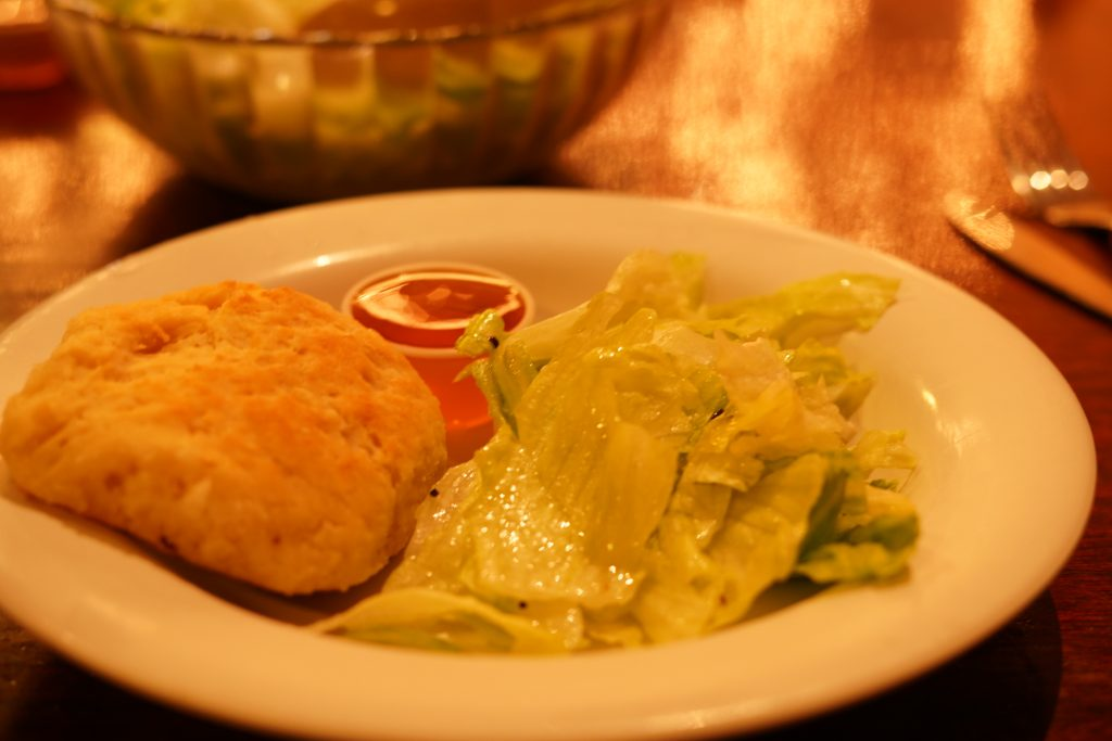 Plate of salad and biscuit at Babe's Chicken restaurant.   A Guide to Granbury, Texas