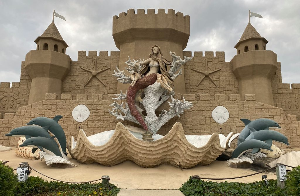 Large elaborate sandcastle with dolphins and a mermaid. | Lively Beach in Corpus Christi, Texas
