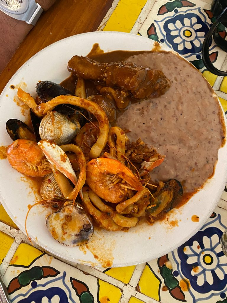 Plate of seafood at a restaurant. | All About XeI-Ha Park in Riviera Maya