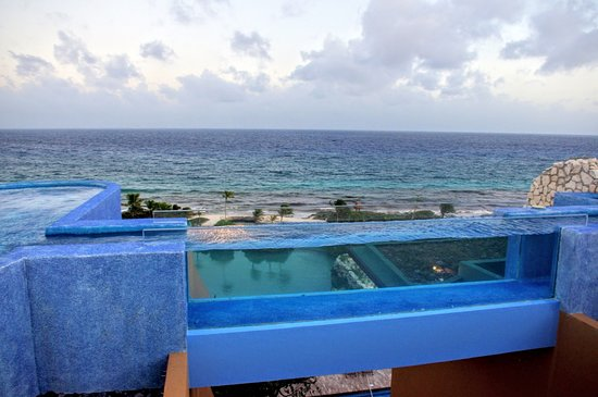 See-through pool bridge at the hotel.  Guide to Hotel Xcaret in Mexico