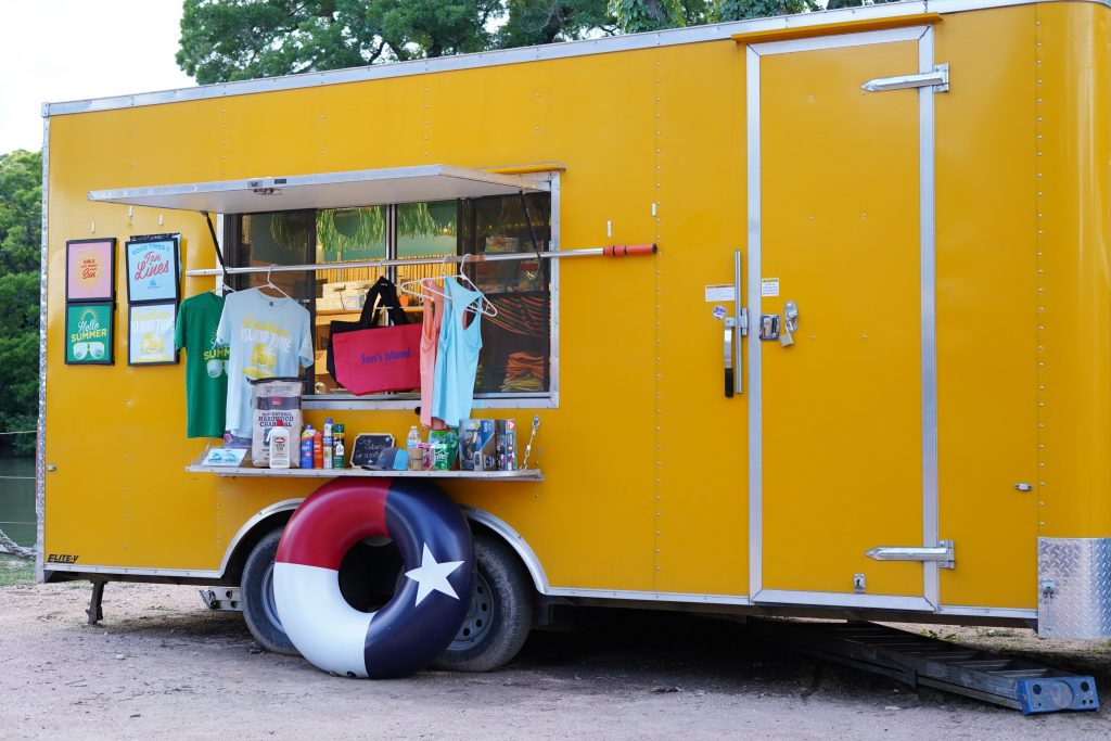 Trailer shop selling t-shirts and souvenirs at Son's Island.| Son's Island in Seguin, Texas