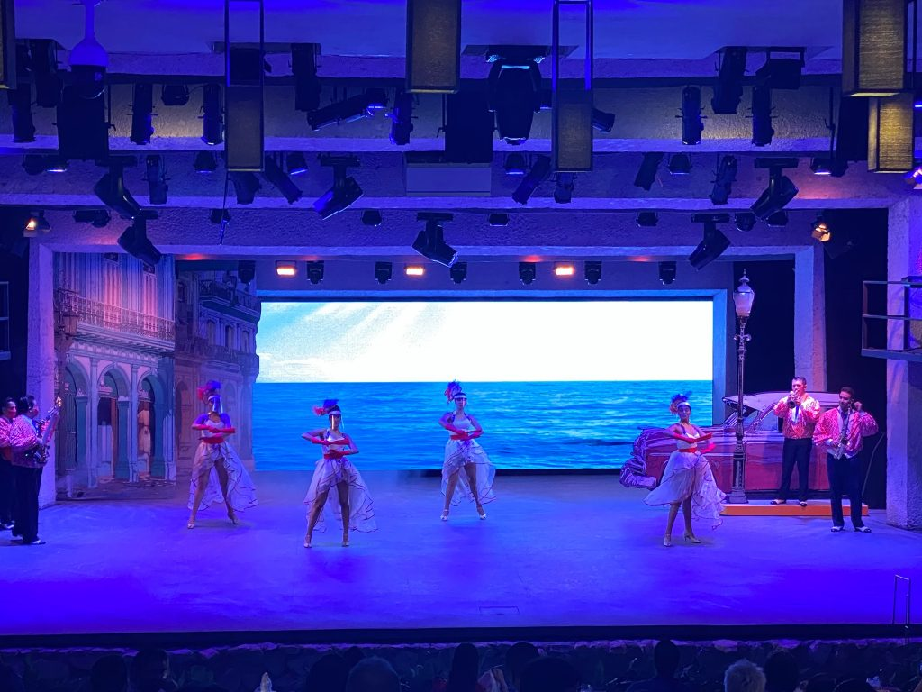 Teatro Del Rio show with dancers on stage.   Guide to Hotel Xcaret in Mexico