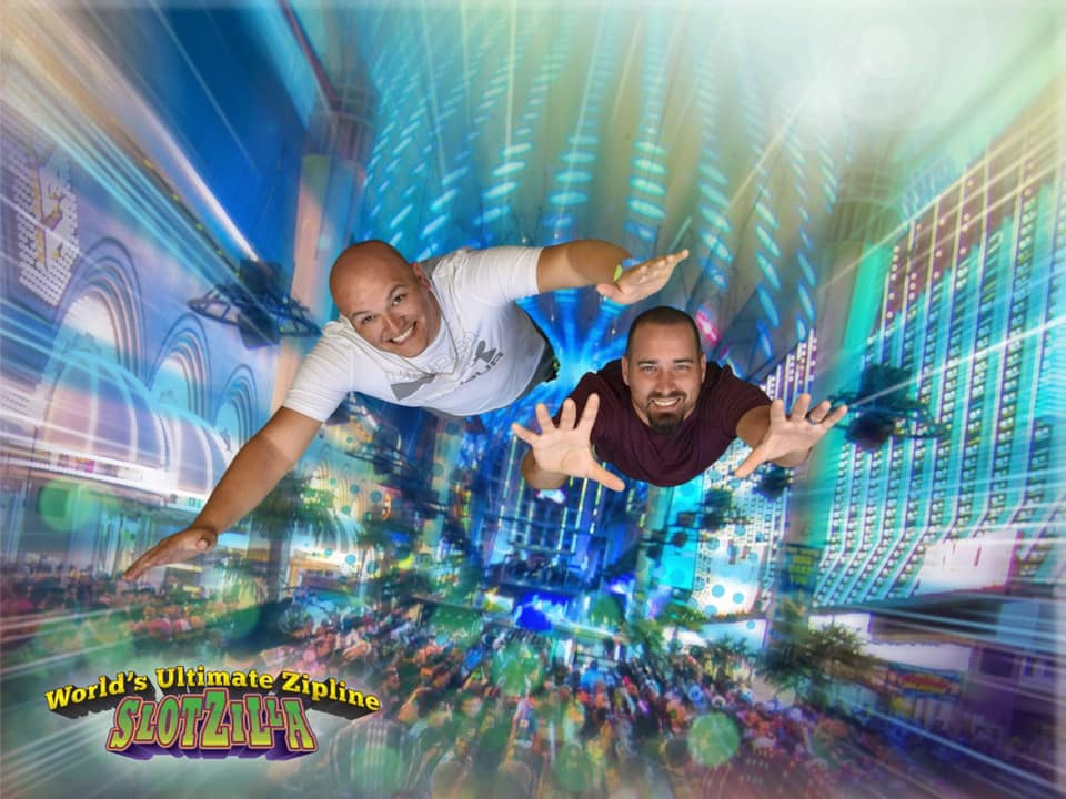 Two men in a simulated flying game called Slotzilla.   Non-Gamblers Guide to Las Vegas