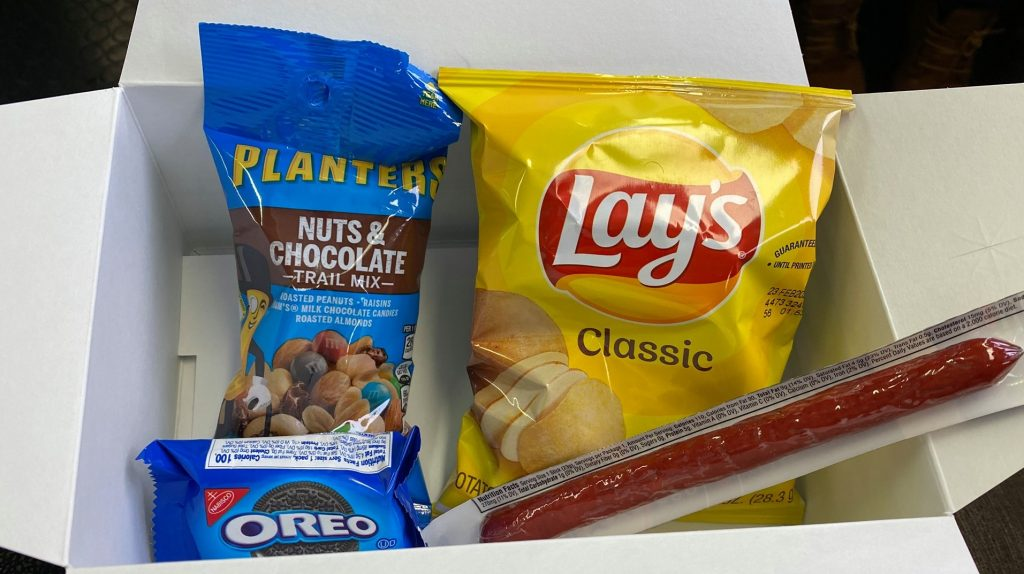 Snack foods on the train including trail mix, oreo cookies, chips and beef jerky. | Grand Canyon Railway in Arizona