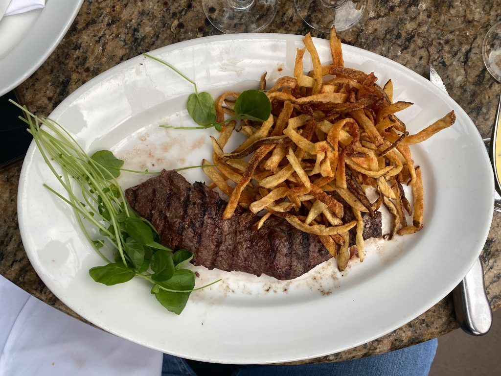 Plate of steak and french fried with greens as a garnish.   Where to eat in Las Vegas