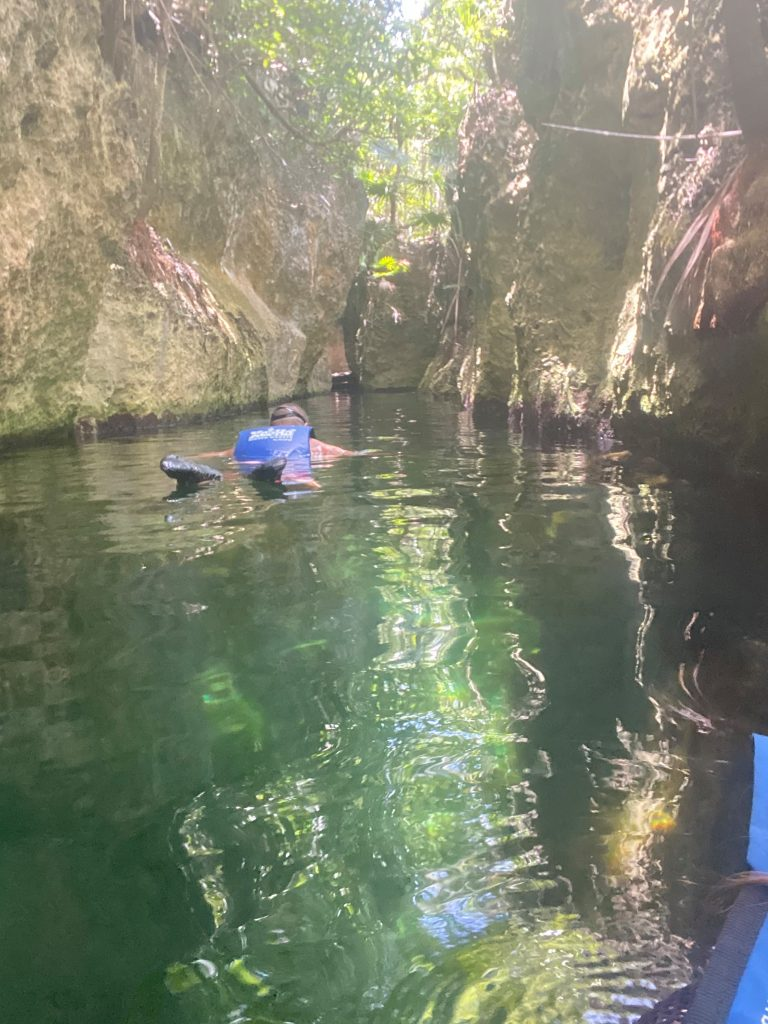 Man swimming. | All About XeI-Ha Park in Riviera Maya