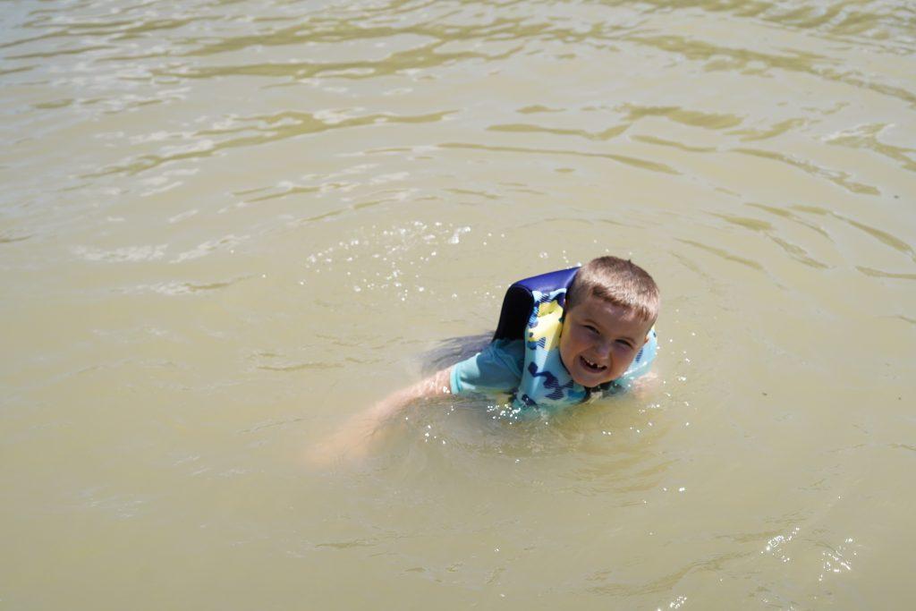 Little boy swimming at Son's Island.| Son's Island in Seguin, Texas
