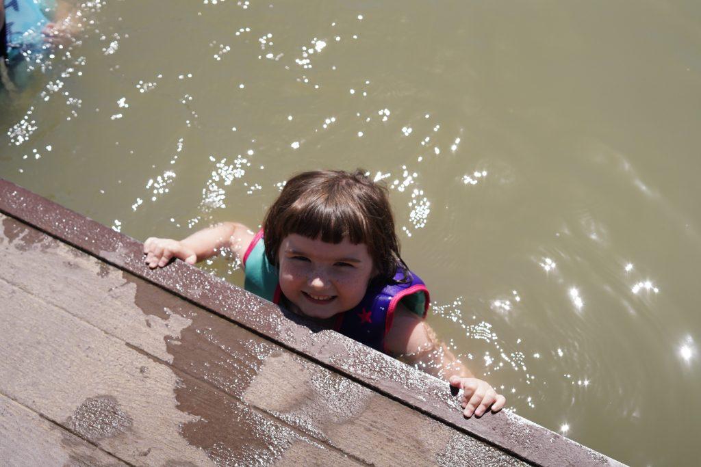 Little girl swimming at Son's Island.| Son's Island in Seguin, Texas