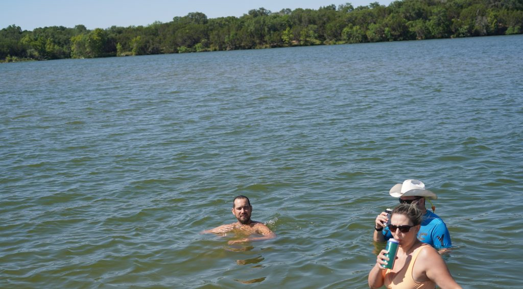 Group people of swimming and hanging out in the water. | Adult Summer Vacation on Lake LBJ