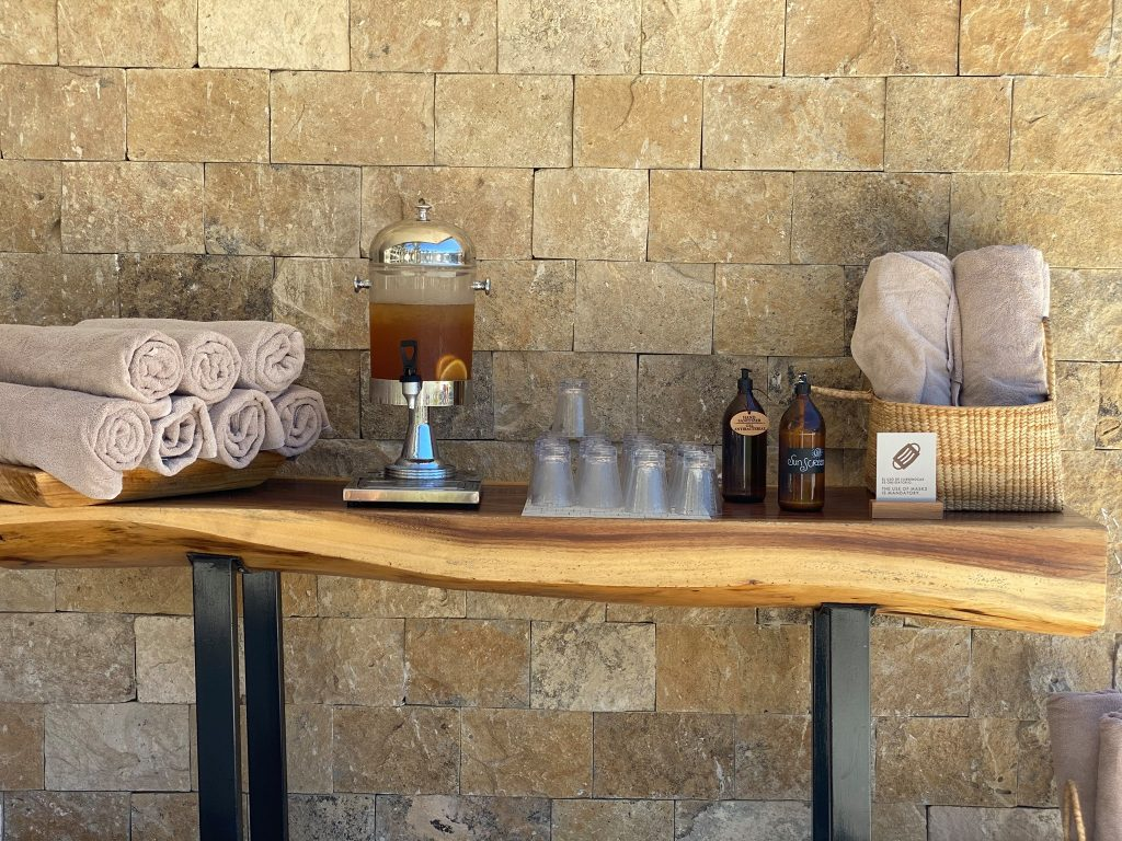 Drink and towel station in front of pool cabana. | A Guide to Nobu Hotel Los Cabos - A Relaxing Girls Trip