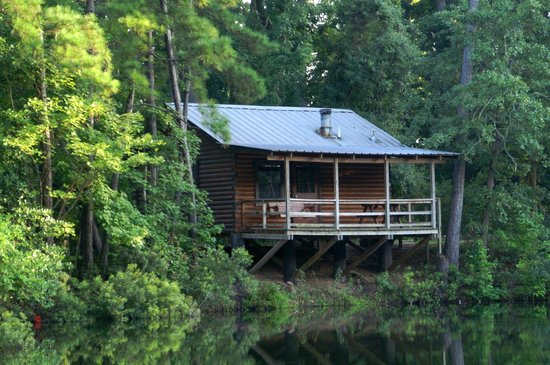 View of the retreat cabin in the woods at the lake.| The Retreat at Artesian Lakes in Texas