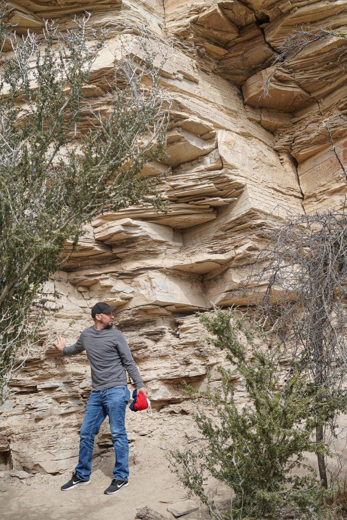 Man leaning against rocks on trail to hot springs at Big Bend. | Big Bend National Park 1-Day Itinerary