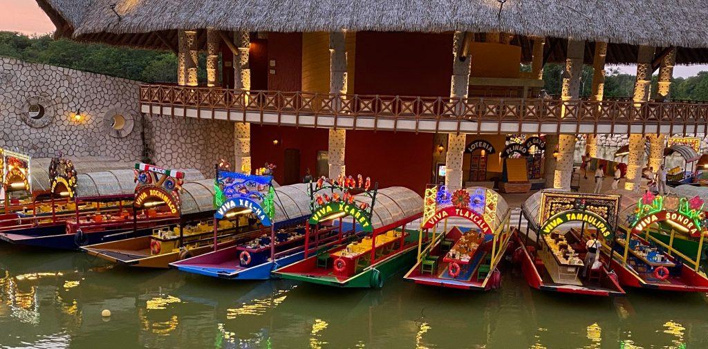 Colorful boats trajinera at Viva Chiapas in Mexico Park. | XOXIMILCO Cancun, Mexico