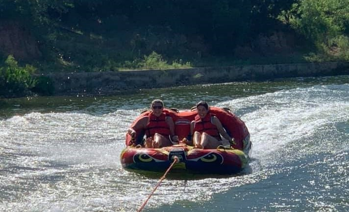 Two women riding on tubes in the water. | Adult Summer Vacation on Lake LBJ