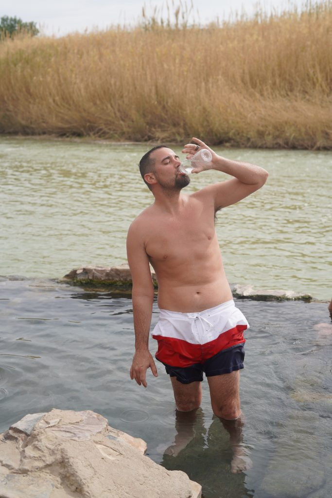 Man drinking water in the hot springs at Big Bend. | Big Bend National Park 1-Day Itinerary