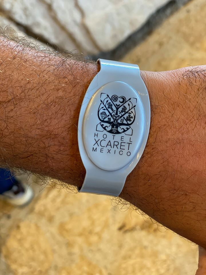 Man wearing a Hotel XCARET Mexico wrist band   Guide to Hotel Xcaret in Mexico