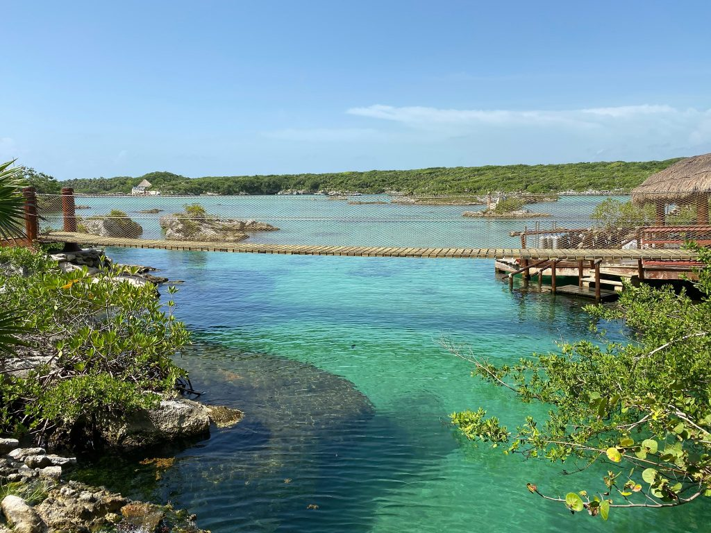 Bridge and water with hut at Xei-Ha. | All About XeI-Ha Park in Riviera Maya