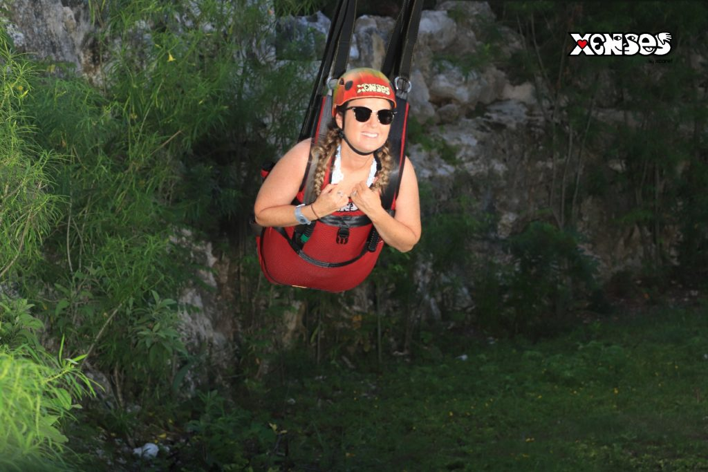 Woman ziplining in the jungle.   Guide to Hotel Xcaret in Mexico